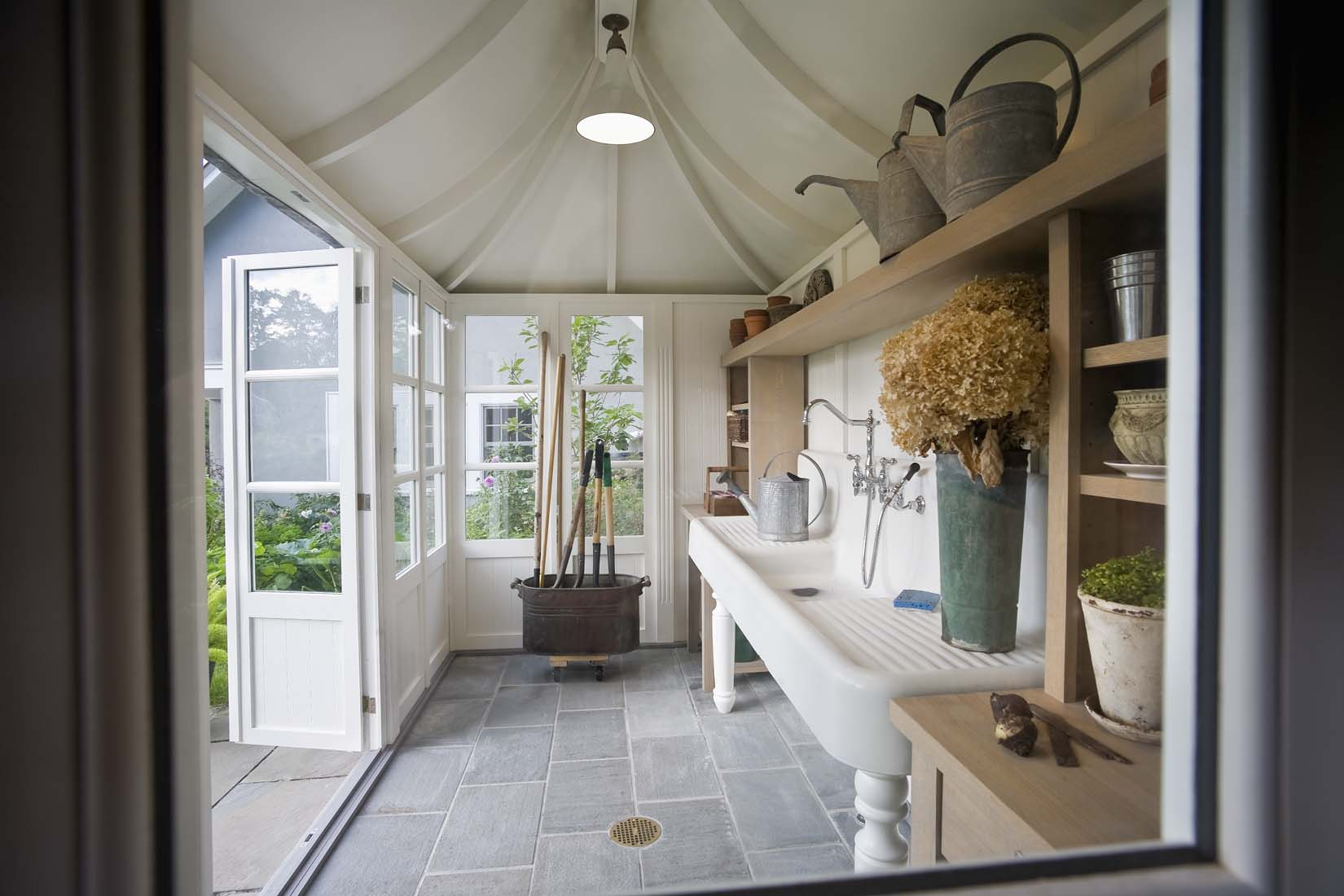 Interior Of Garden Shed With Large Utilitiy Sink, Stone Floor And Doors  Open To Garden