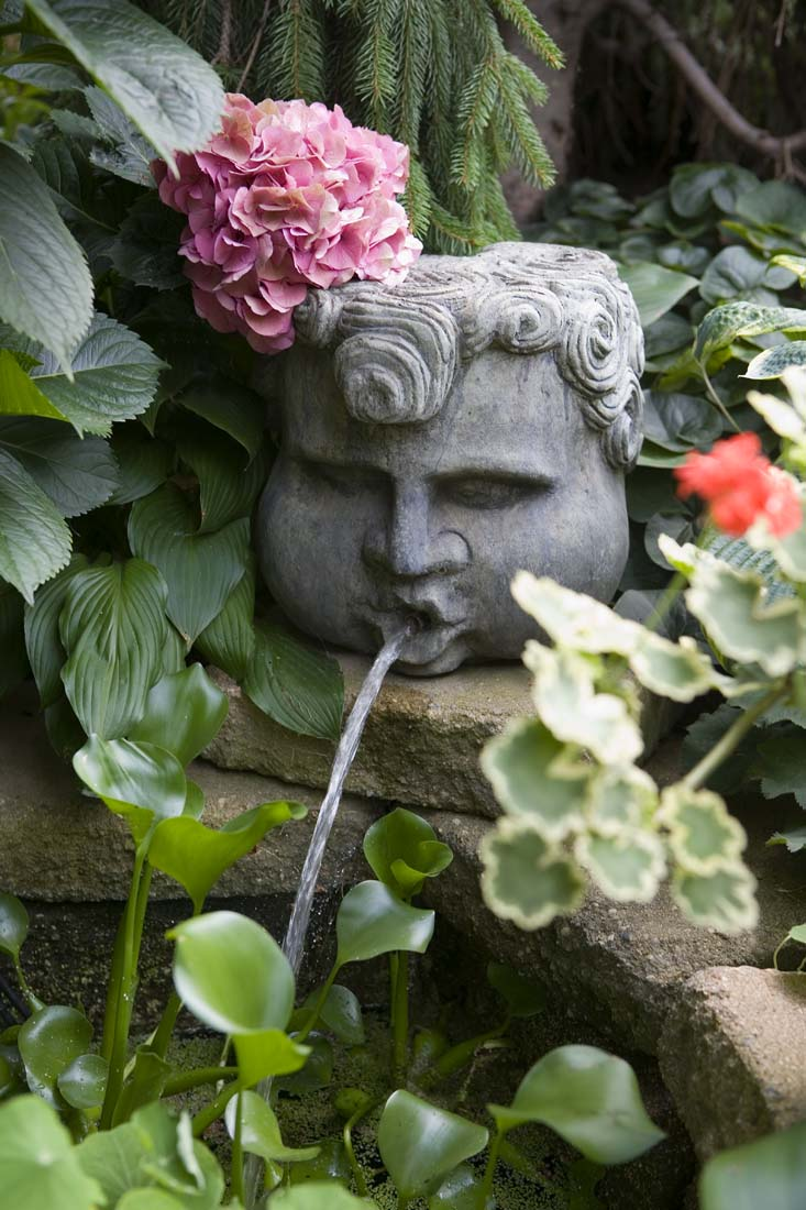 Andrea rugg photography gardens and landscape photography stone head with water fountain coming out of mouth in garden workwithnaturefo