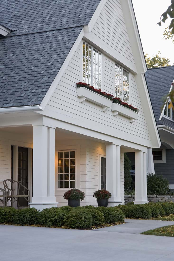 Andrea Rugg Photography   Large A-frame front dormer and pillars of ...
