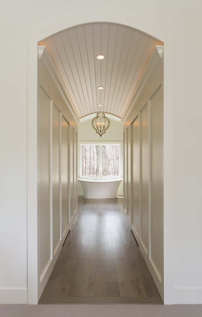 Andrea Rugg Photography | Long hallway leads to bathroom and large ...