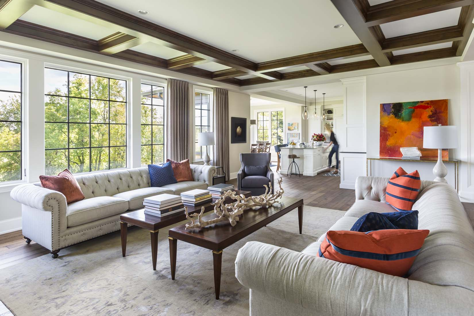 Upscale living room with neutral colors and accents of bright orange
