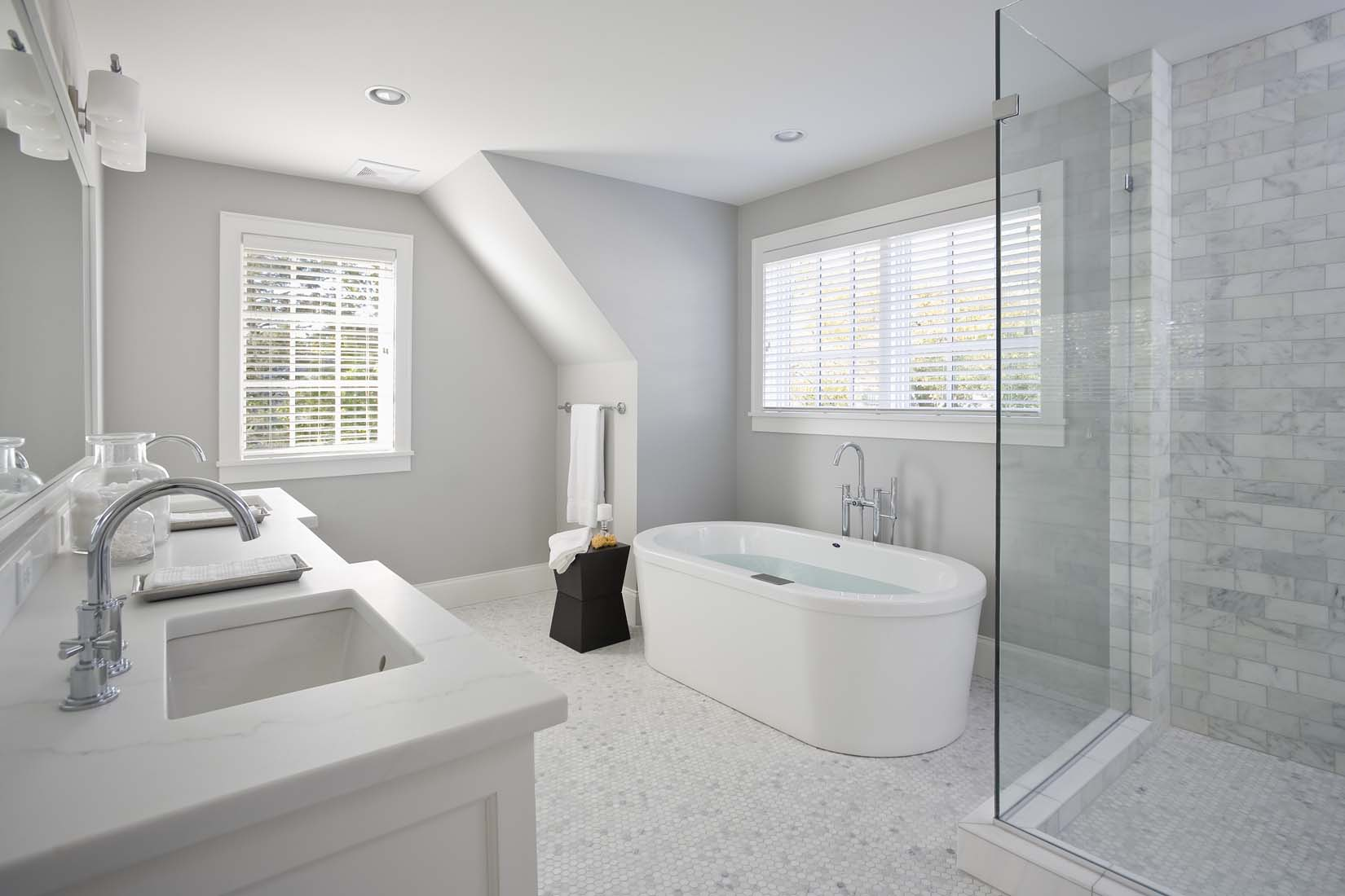 Andrea Rugg Photography | Sleek white bathroom with oval tub and ...