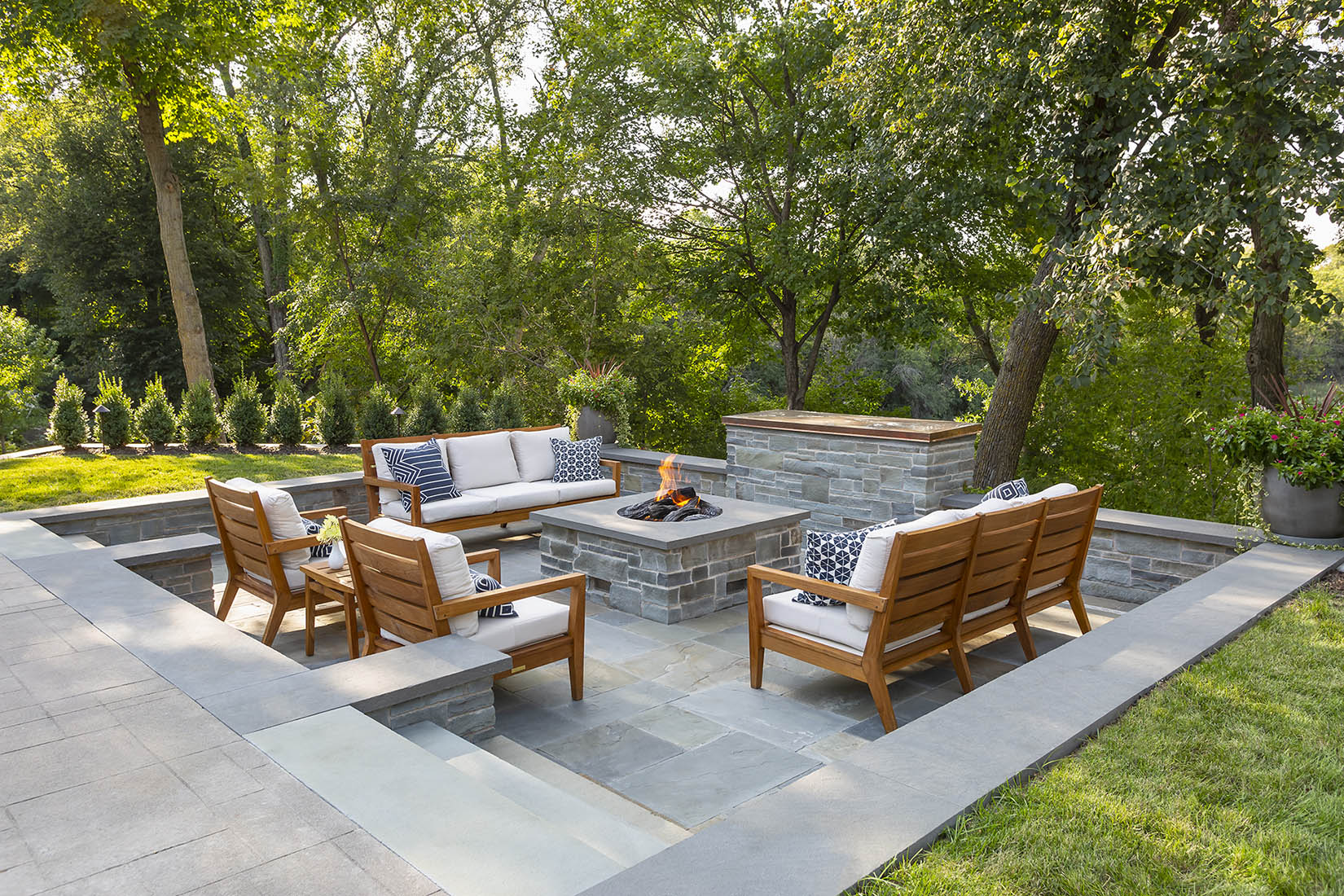 Sunken Blue Stone Fire Pit And Television Area In Garden With Teak